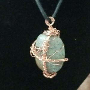 Turquoise Stone wrapped in copper wire.